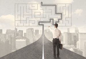 47755850 - businessman looking at road with maze and solution concept
